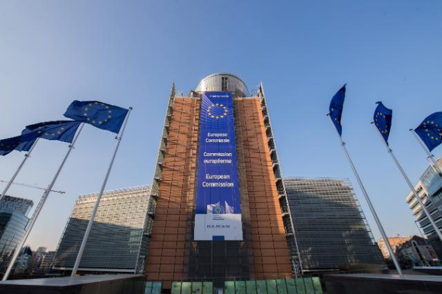 Views of European flags in front of the Berlaymont building in Brussels